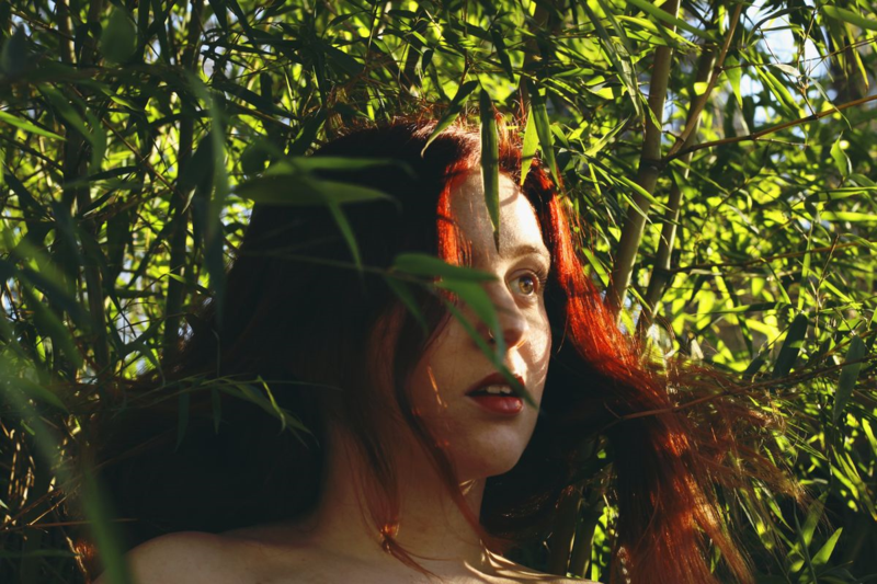photos I took of myself Sienna Rose Gray for a school assignment at lane community college in my photo one class for my portraits. red headed girl standing amongst bamboo in eugene oregon